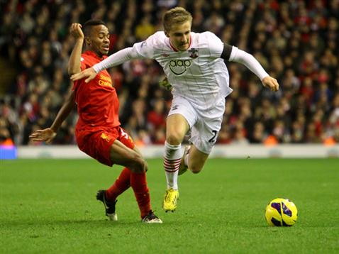 Luke Shaw gets the better of Liverpool's Raheem Sterling