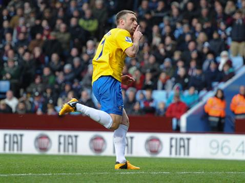 Rickie Lambert celebrates his winner in front of the Holte End