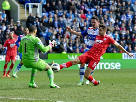 Jay Rodriguez beats Adam Federici to the ball to give Saints the lead at Reading.