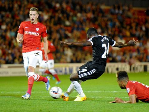 Emmanuel Mayuka scores his first competitive goal for Saints at Oakwell.