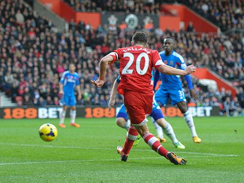 Adam Lallana applies the finishing touch to a fantastic solo effort to put Saints 3-0 up against Hull City